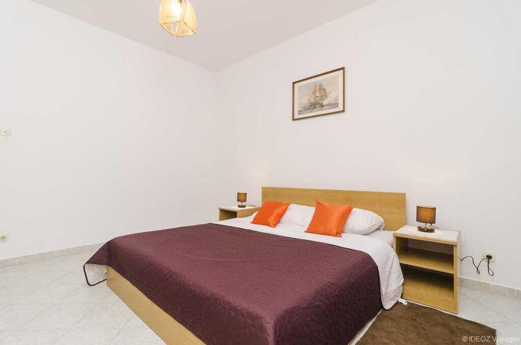 chambre de l'un des appartements  cumbelic à Kozarica